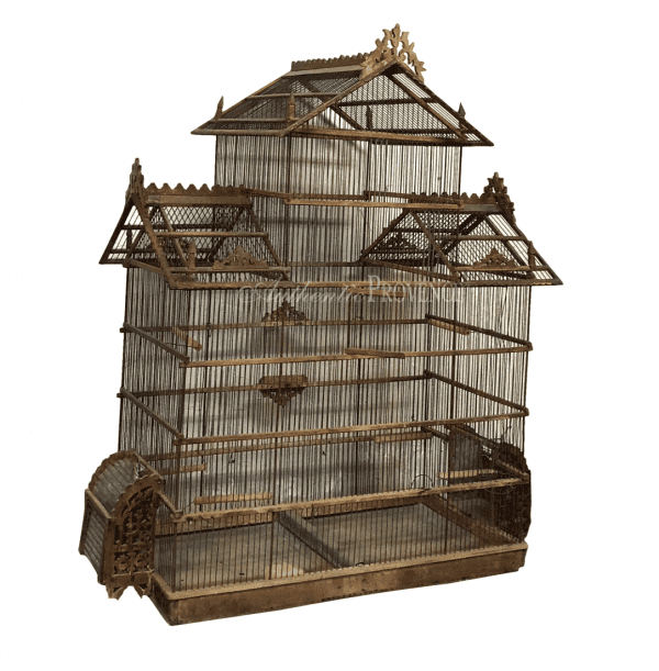 Antique French wire birdcage in pagoda shape made of walnut. The roof is decorated with filigree tracery carving in good condition.