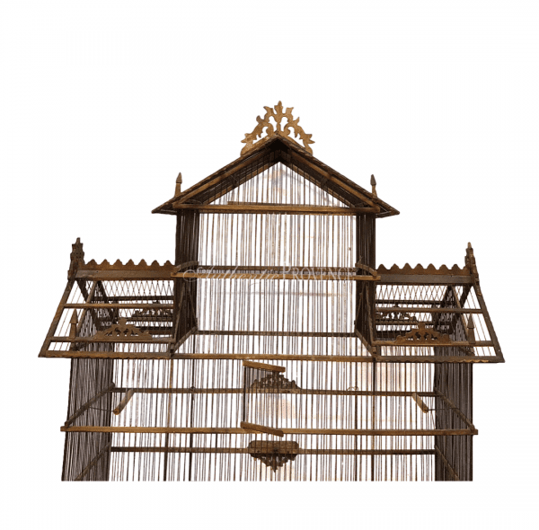 Close up of antique French wire birdcage in pagoda shape made of walnut. The roof is decorated with filigree tracery carving in good condition.