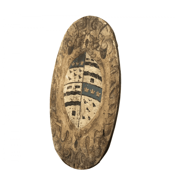 Side view of a hand painted oval family crest from Tuscany in Pinewood with minor cracks and small losses.