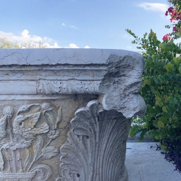Close up of Impressive wellhead, hand sculpted in Istrian marble with Acanthus relief décor, birds, and crest dated 1521