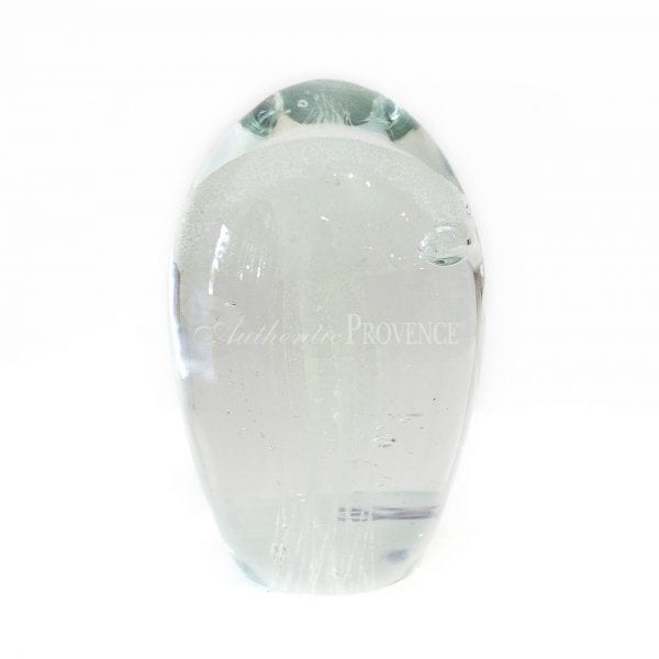 Upright decorative paperweight in clear glass with a white inclusion representing a jelly fish
