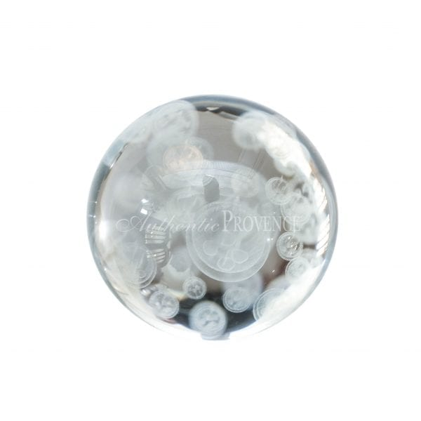 Tiny decorative paperweight of demi lune shape and with a mirrored glass backing.