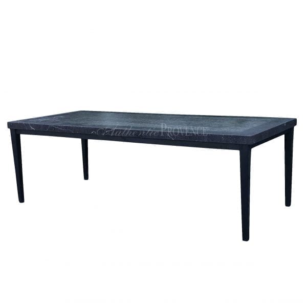 Side view of a large rectangular Bluestone dining table with hammered metal tapered legs