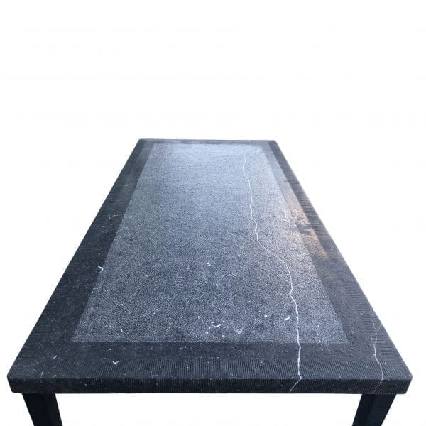 Overhead view of a rectangular Belgian bluestone table with metal tapered legs