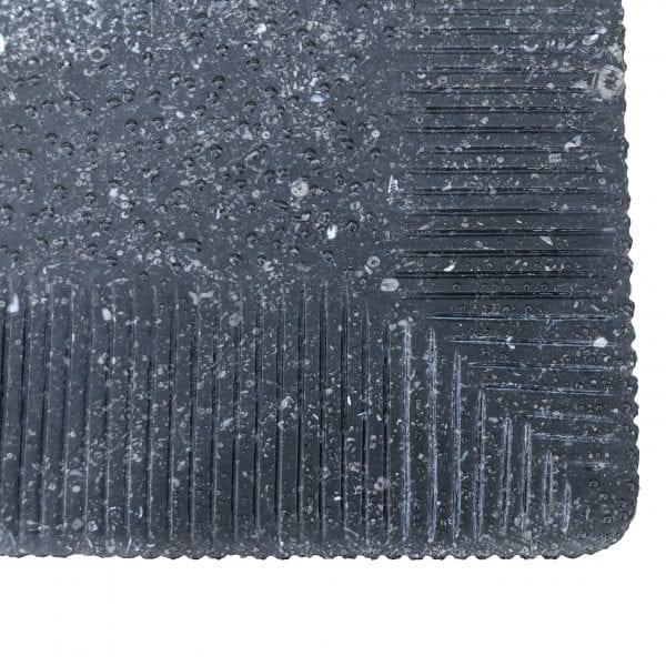 Close up of the corner of a rectangular Belgian bluestone table