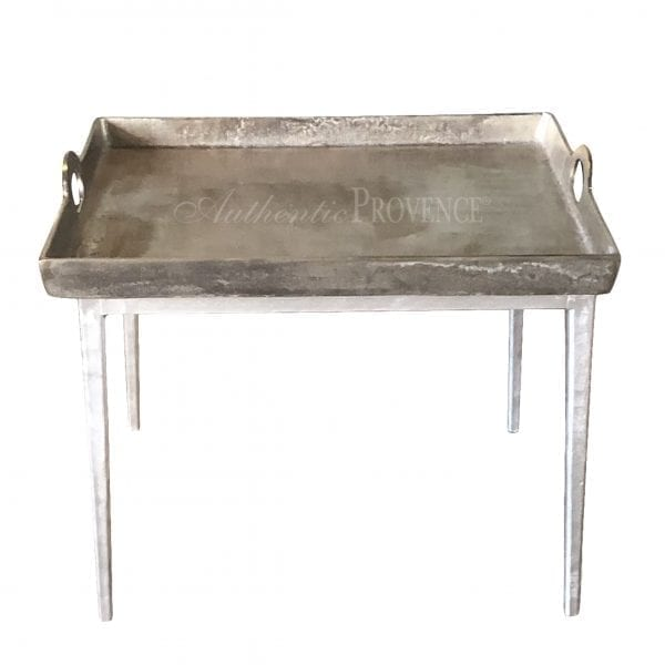 Overhead view of a Belgian side table with hammered aluminum tray with lateral handles on metal tapered legs