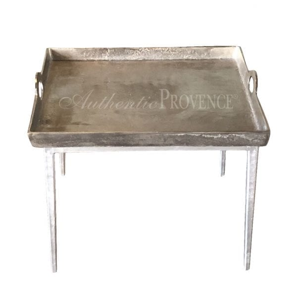 Overhead view of a side table with hammered aluminum tray with lateral handles on metal tapered legs
