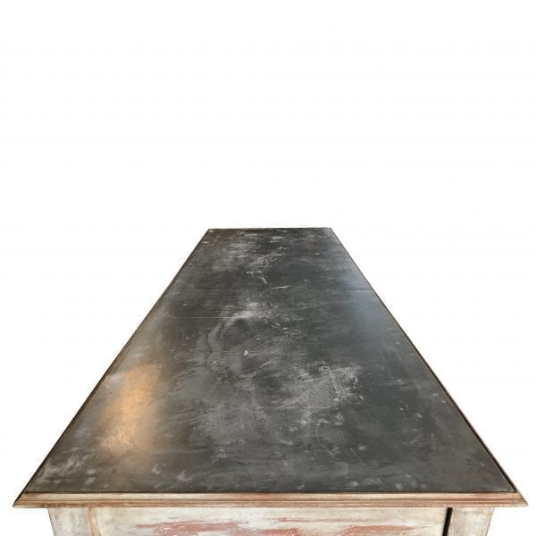 Overhead view of a large rectangular table with rustic galvanized metal top
