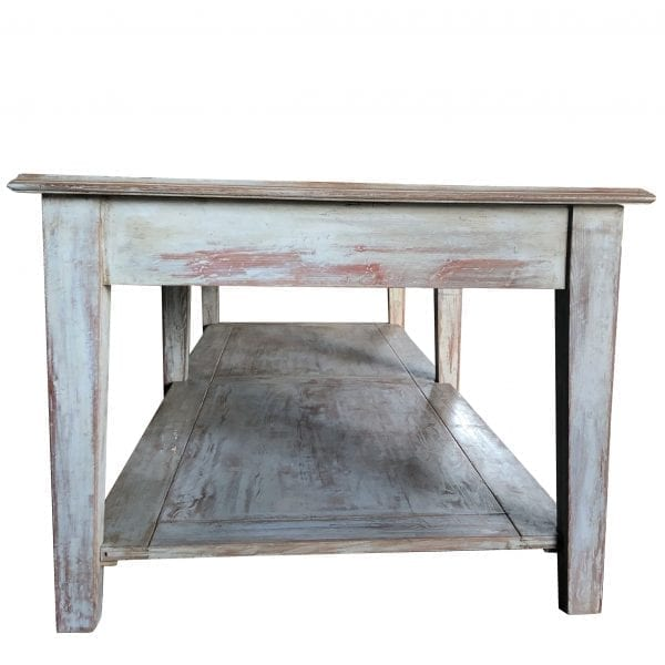 Side view of a rectangular garden table with rustic galvanized metal top and wooden base with bottom shelf