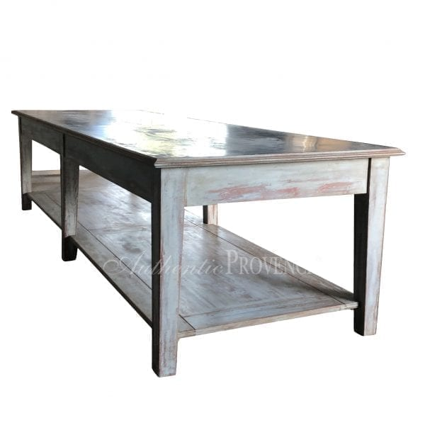 Back view of a rectangular garden table with rustic galvanized metal top and wooden base with bottom shelf