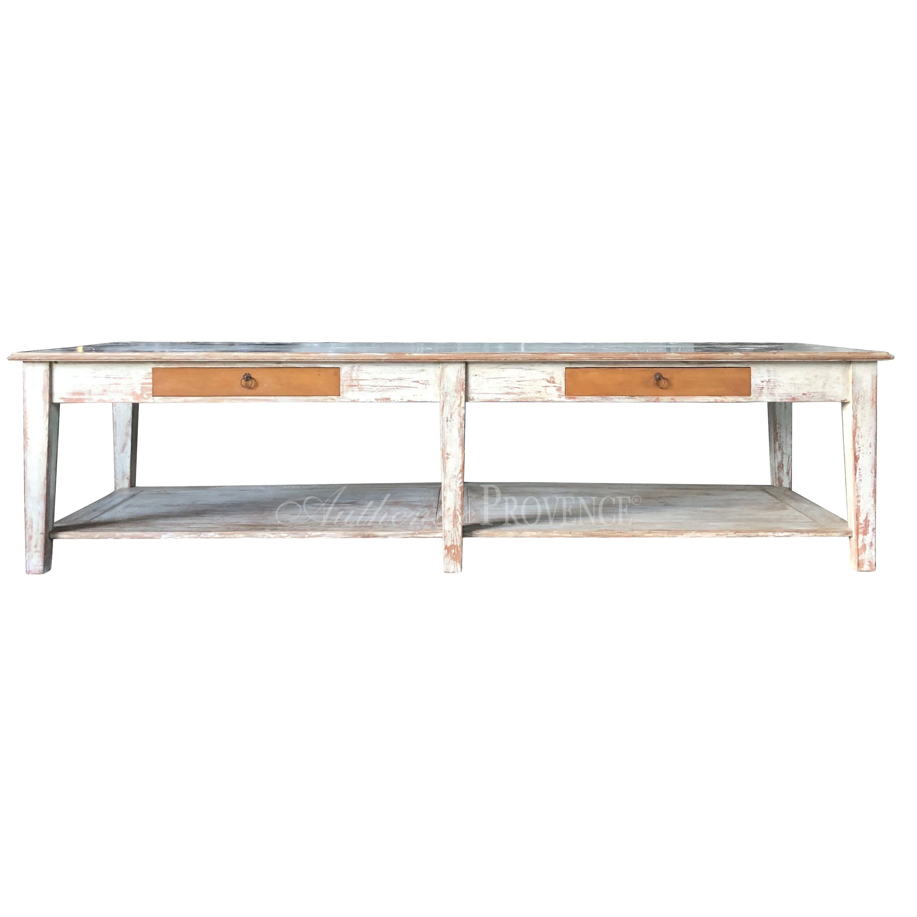 Front view of a large rectangular garden table with rustic galvanized metal top and wooden base with two faux drawers and bottom shelf