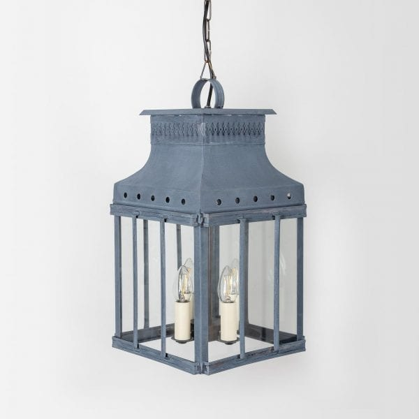 Historical French carriage pendant lantern topped with a handle and three vertical bars.