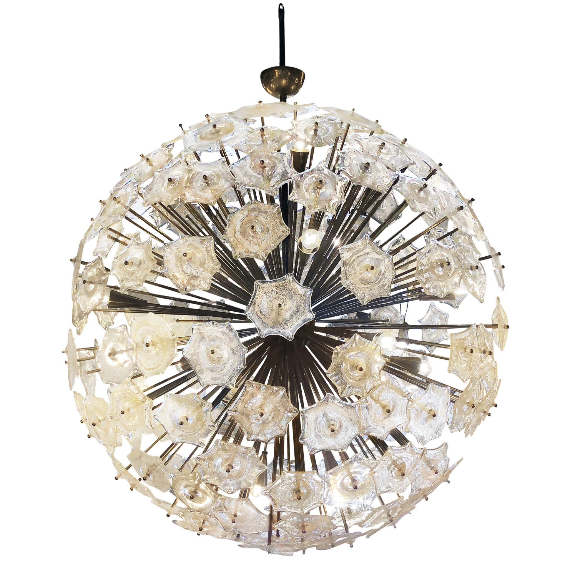 Mid-Century modern Italian chandelier of round shape with octagonal heavy Murano glass elements and 12 light sockets. Circa 1958 - 1960 Murano, Italy