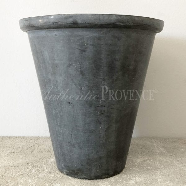 Small metal planter made of lead with rim