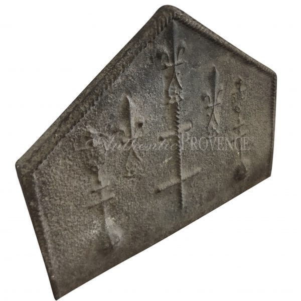 Side view of cast iron fireback with cross decor in Neogothic style
