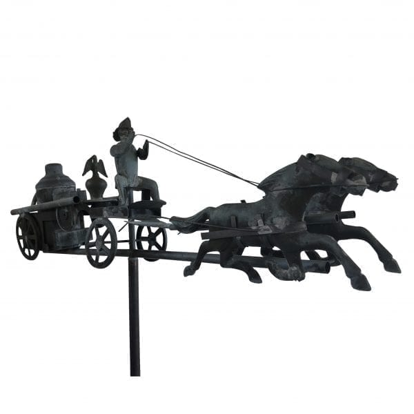 Side view close up of French copper weather vane installed on a copper pole featuring two horses pulling a carriage