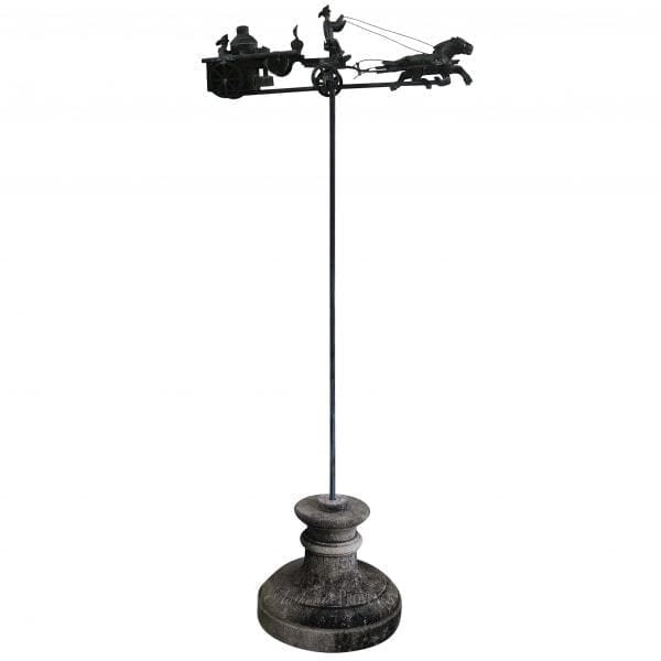 Extraordinary French copper weather vane featuring two horses pulling a carriage. Installed on a copper pole and set onto a round limestone base.