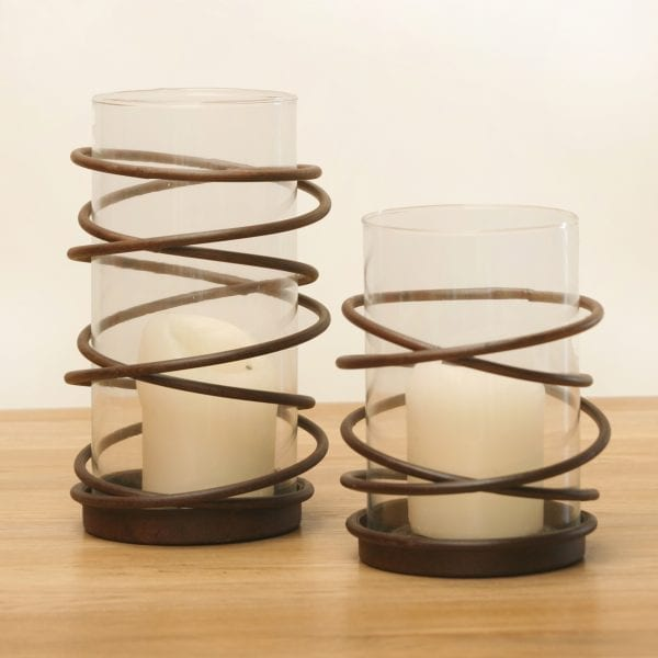 Contemporary glass hurricane inserted into a spiral metal holder from Belgium.
