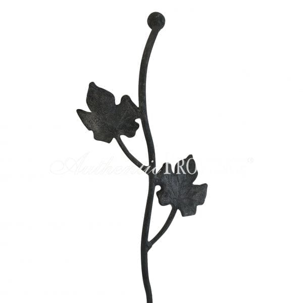 Close up of tall decorative garden stake with leaf ornaments