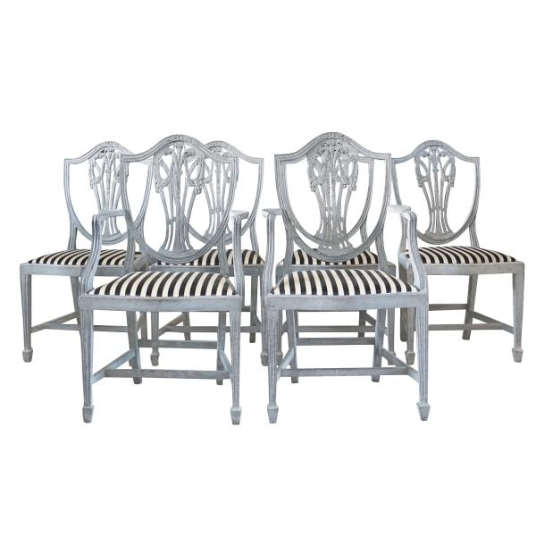 Set of 19th century chairs composed of two armchairs and four side chairs with very fine Neoclassical carvings and upholstered in a striped fabric
