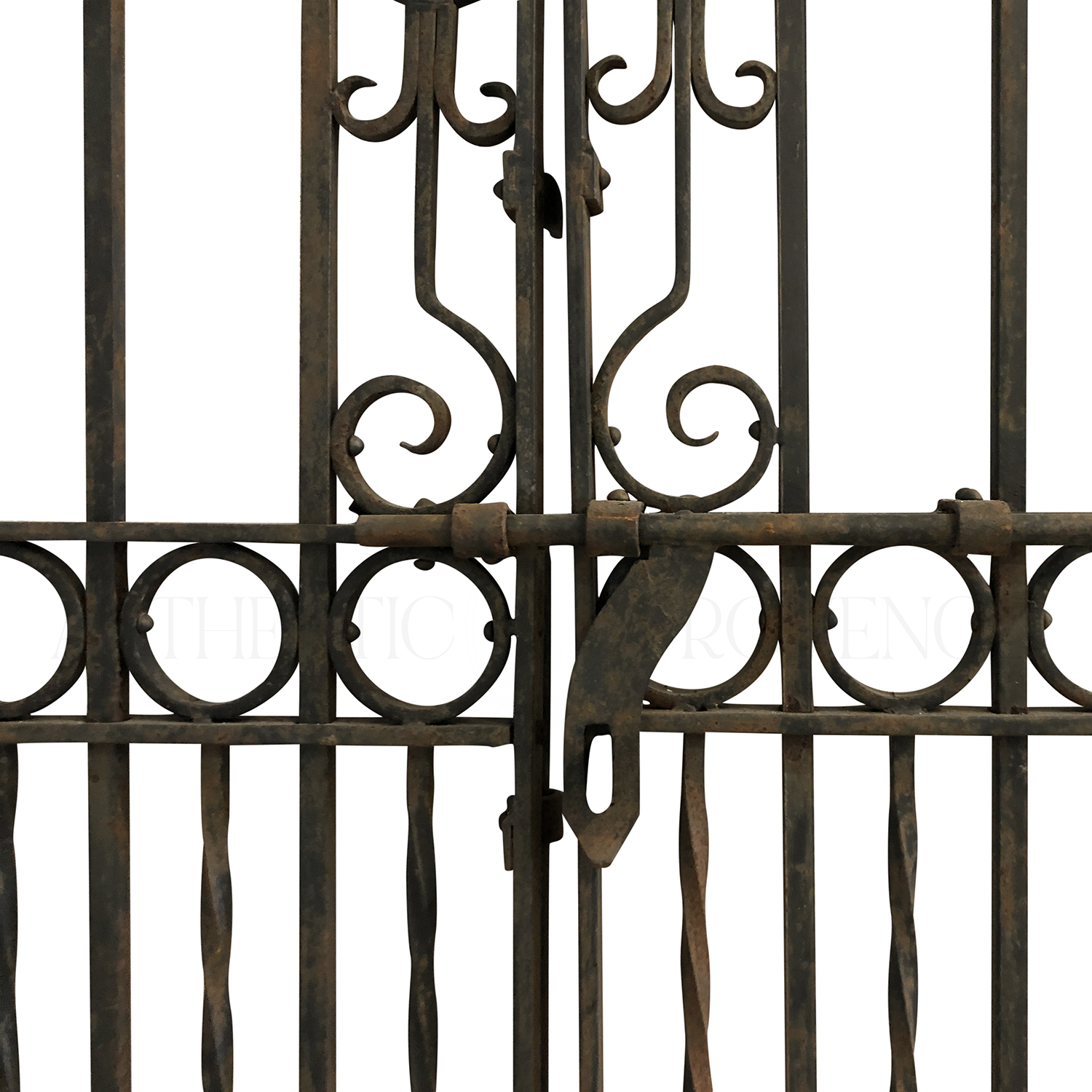 Close up of a heavy double sided wrought iron entrance gate from the early 19th century