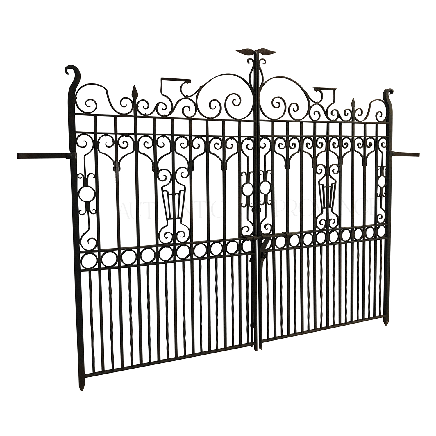 A heavy double sided wrought iron entrance gate from the early 19th century with the typical French décor
