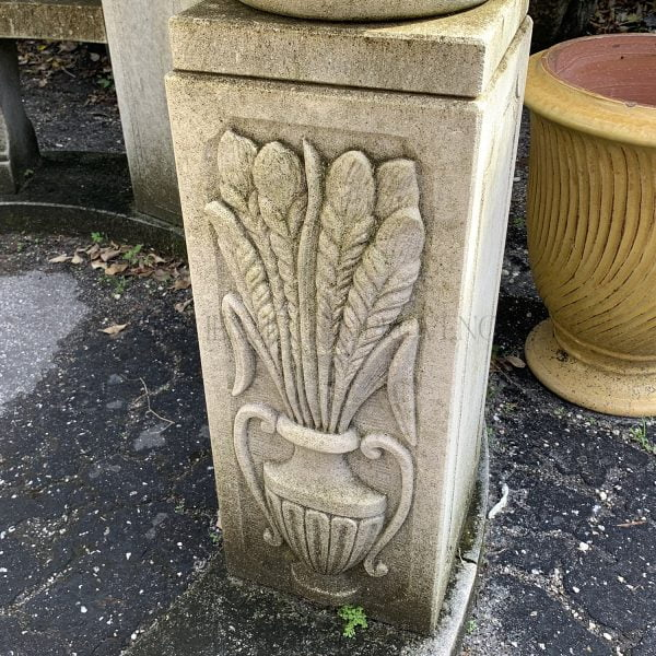 Close up of the base of a five column limestone gazebo