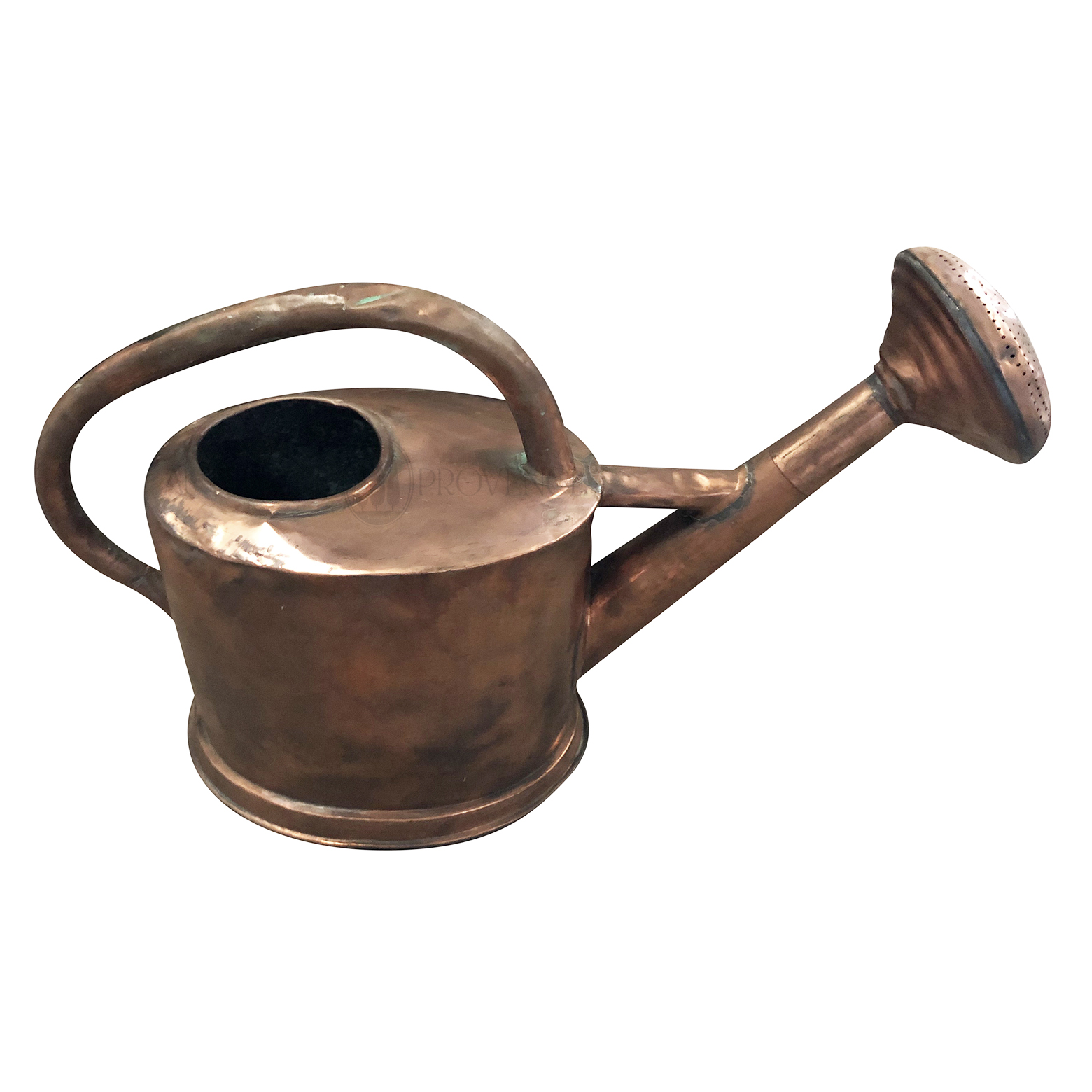 Overhead view of an antique French watering can in copper