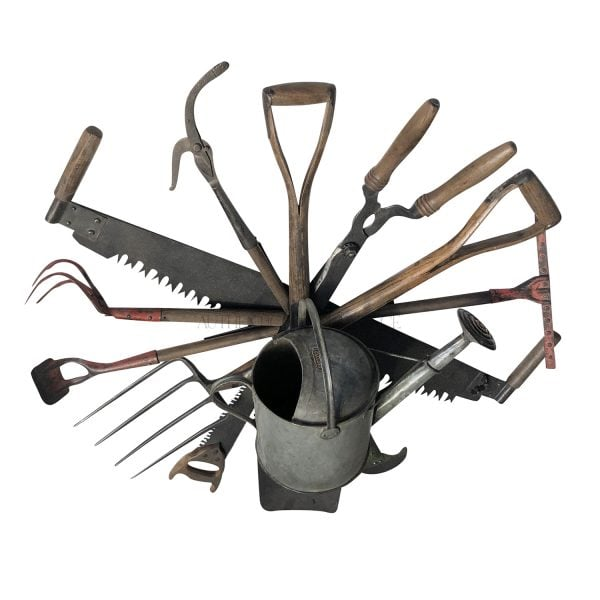 Overhead view of a wall mount antique tool wreath composed of late 19th Century English garden tools with a centered watering can