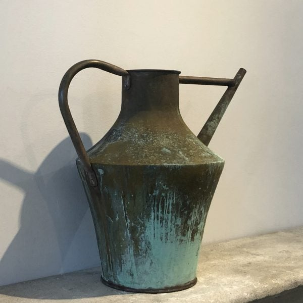 A large amphora shaped 19th century tapered copper watering can with a natural antique patina