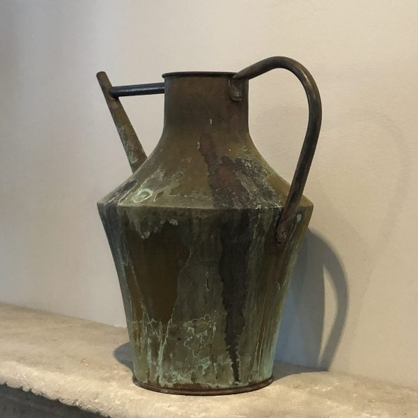 A large amphora shaped antique tapered, back handled watering can in copper with a natural antique patina