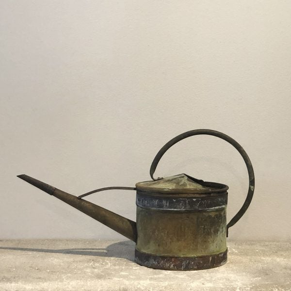 A small 19th century copper watering can with a narrow spout with a natural antique patina