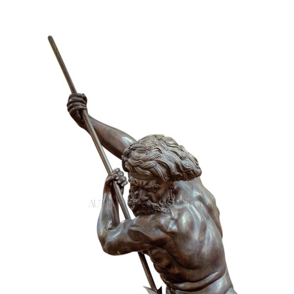 Close up of an impressive Italian fountain head made of dark bronze representing the greek god Neptune holding a sharp spear